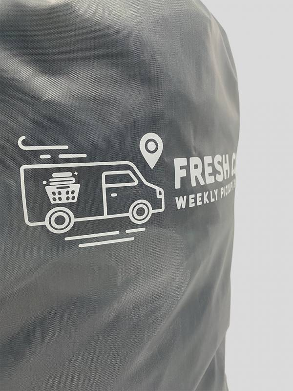 close up image of the fresh clothes logo on a polyester bag